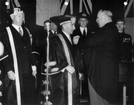 Chancellor Sherwood Lett receiving a decoration from Lieutenant Governor Frank Ross