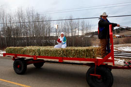 Day 91 Torchbearer 80 Tricia Beauvais carries the flame on a hay wagon in 108 Mile Ranch, British...