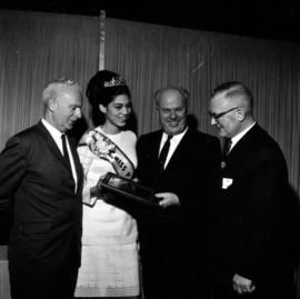H. Fairbank, H.J.C. Terry, H.W. Mullholland, and Miss P.N.E. at Pacific Coliseum opening event