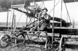 William A. Straith [at the controls of a Farman Pusher Biplane]