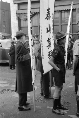 [Boy Scout and man with banner for funeral procession]
