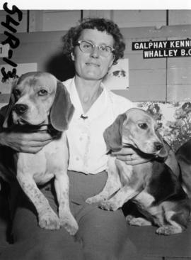 Woman with P.N.E. all-breed dog show entries [beagles] in Dogs and Cats building