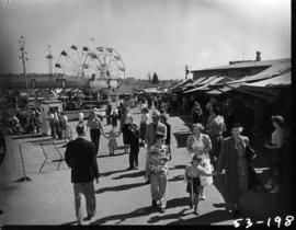 View of tents and amusement rides in P.N.E. Gayway