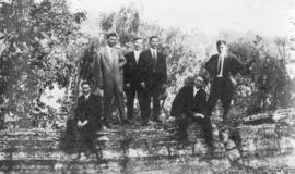 [Group of unidentified young men in a garden]