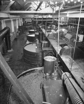 [Man checking pulp vats at] Pacific Mills