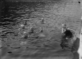 People swimming off a dock