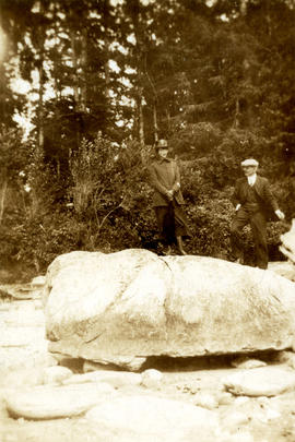 [L.D. Taylor and an unidentified woman standing on a large rock]
