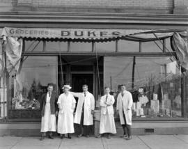 Employees in front of Duke's Grocery [1588] Commercial Drive, 1920