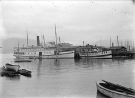 "[Ships ""Joan"" and ""Defiance"" at Evans, Coleman and Evans dock]"