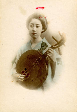 [Studio portrait of a woman in formal Japanese dress holding a stringed instrument]