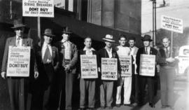 [Province Newspaper employees wearing signs on the picket line]