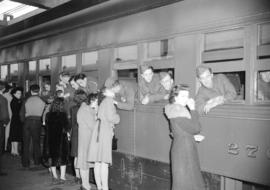 [Troops leaning out of train windows to say farewell to friends and family on the CNR station pla...