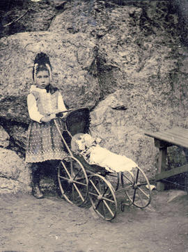[Portrait of girl with a doll's buggy]