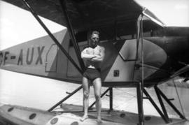 Karl Koenig posing on sea plane