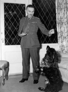 Brigadier Sherwood Lett at home with dog