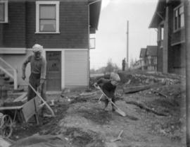 [Jack Davidson and a labourer in the backyard of 2119 West 42nd Avenue]