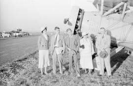 [Unidentified group beside an airplane]
