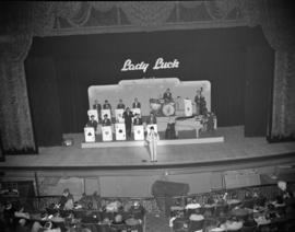 "[Dal Richards and his band on the Orpheum Theatre stage playing at the ""Lady Luck Revue""]"