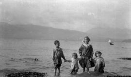 [James, Theresa, Rose and Kenelm Quiney wading at the beach at the foot of Alma Street near Camer...