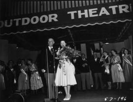 Miss P.N.E., Lynn Adcock, holding trophy on Outdoor Theatre stage