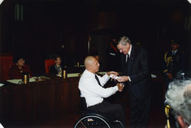 Roméo LeBlanc presents certificate to Paralympic athlete in council chambers