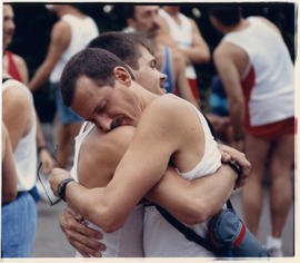 Two men hugging at marathon race in Stanley Park