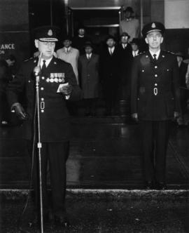[Change of command ceremony outside 312 Main Street with - Chief Constable Archer ]
