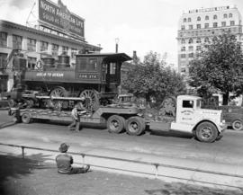 [C.P.R. locomotive 374 being transported to Kitsilano Beach]