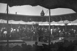 [View of horse and rider performance from tent at Recreation Park]