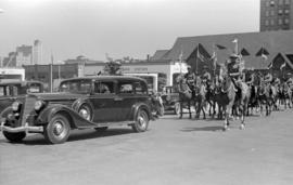[Mounted R.C.M.P. on parade on Georgia Street west of Burrard Street]
