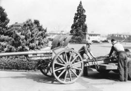 [German field gun being removed from grounds of Legislature]