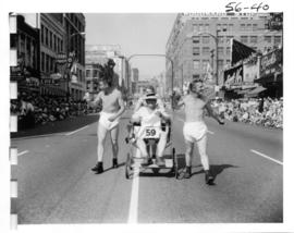 Men dressed as babies in 1956 P.N.E. Opening Day Parade