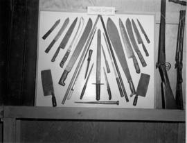 Display of knives, swords, and rifles