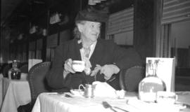 [Woman seated in a Canadian Pacific Railway dining car]