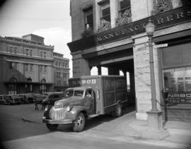 [Nabob delivery truck leaving a building at Cordova and Water Street]