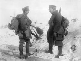 [Two soldiers in discussion behind the line at the Western Front]