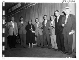 "Group holding keys on Outdoor Theatre stage, likely winners of the Bowell McLean ""A Car A Da..."