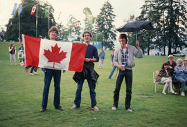 Three men with Canadian flag during the Centennial Commission's Canada Day celebrations