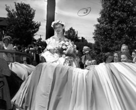 Close-up of Kitsilano Queen, Miss McNiven riding on parade float
