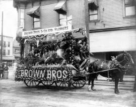 [Horse drawn Brown Bros. May Day float at Hastings and Columbia]