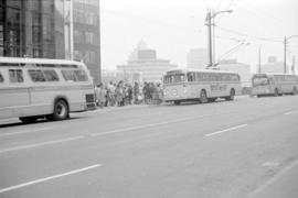 Three buses outside the Eaton's Building