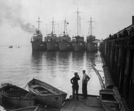 [A row of ships at dock]