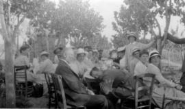 [Emily Matthews at table with nurses and soldiers]