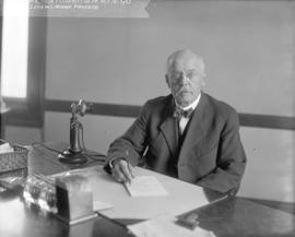 [Mr. Babcock of the Provincial Fisheries Department seated at desk]