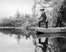 [L.D. Taylor standing in a boat and fishing]