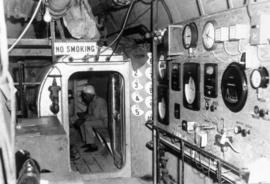 Highbury tunnel showing worker and gauges