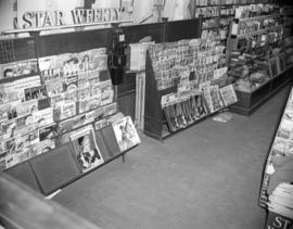 [Magazine rack at Whiles Drug Store, 2202 Granville Street, before installation of new display sh...