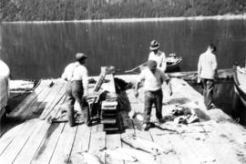[Men on dock with salmon catch, Stuart Island, B.C.]
