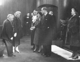 [John Bennett and an unidentified woman greet H.R.H. Princess Elizabeth and H.R.H. Philip Duke of...