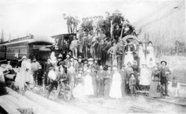 "[Group portrait on and around C.P.R. ""Ocean to Ocean"" locomotive ""401""]"